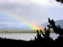 A rainbow over a lake.