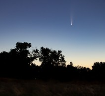 Comet Neowise in the night sky above the American river