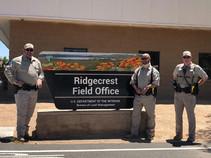 BLM Rangers standing next to the Ridgecrest Field Office sign