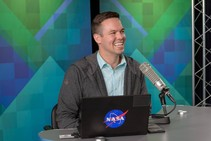 Matthew Buffinton sitting at a desk with a microphone.