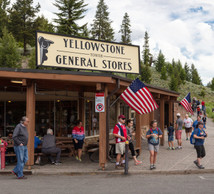 Yellowstone general store with people walking around on the street.