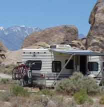 RV parked next to large rocks in the Alabama Hills.