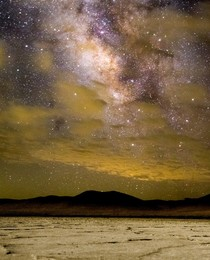 Dry lake bed with galactic core in the sky.