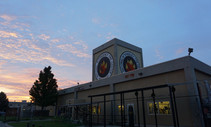 The National Interagency Fire Center building at dusk.