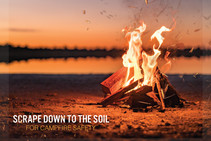 A campfire burning, with the words Scrape down to the soil for campfire safety.