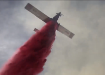 Aircraft dropping fire retardant.
