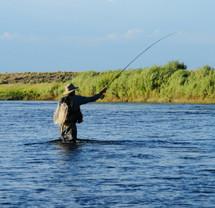 Man fishing in a lake.