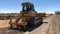 Large excavator on a dirt road.