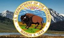 Department of Interior seal in front of a mountain.