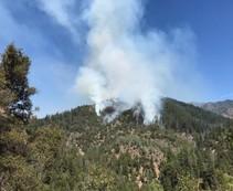 Smoke billowing from a mountain.