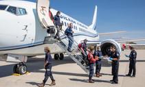Fire crews exiting an airplane.
