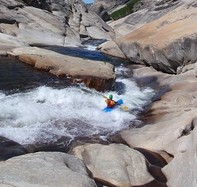 Kayaker in whitewater rapids.