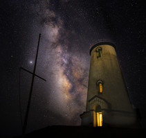 Milky Way galaxy over a lighthouse.