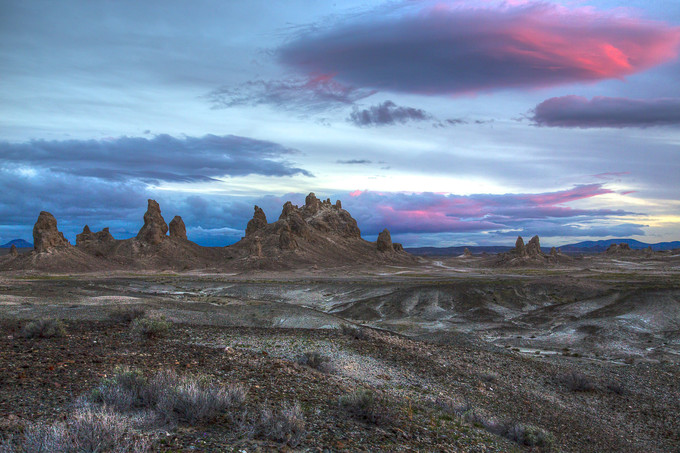 Trona Pinnacles rock formation with a pink sunset in the clouds.