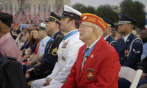 Older veterans sitting for a presentation.