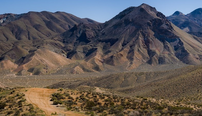 Tall mountain peaks with rolling hillsides leading to them.