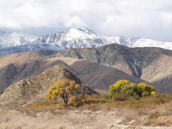 Mountain range with snow on the highest peaks.