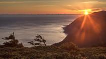 Sunset over a coastal mountain range.