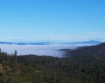 A mountain valley filled with fog.