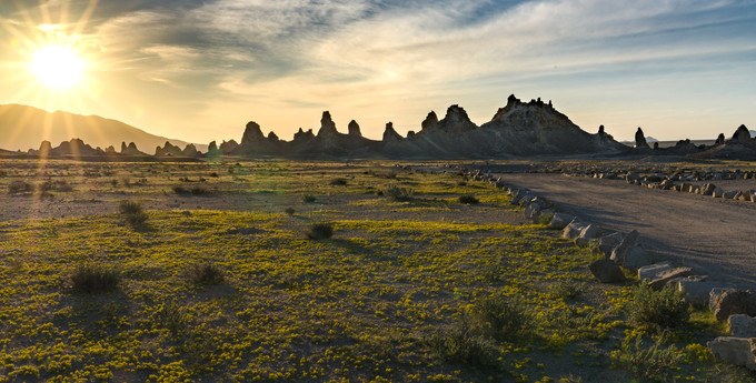 Rock formations against a sunset in a desert.