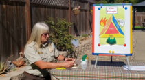 A woman sitting down next to a chart explaining fire triangle.