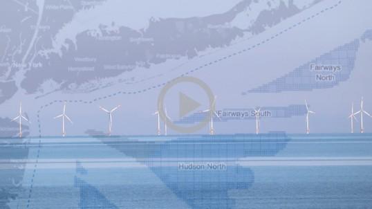 Offshore wind turbines sit in the ocean