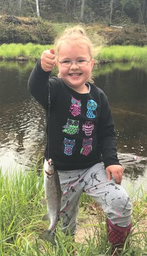 little girl holding trout at PEC kids fishing day