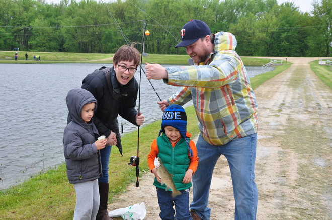 a happy family celbrates their catch at Genoa NFH