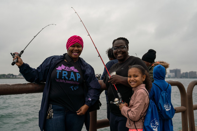 participants enjoy the kids fishing event on the detroit river