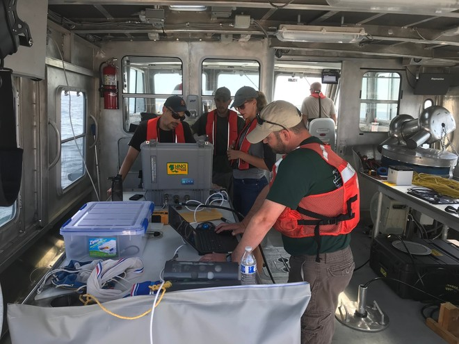 biologists working on hydroacoustics aboard MDNR vessel