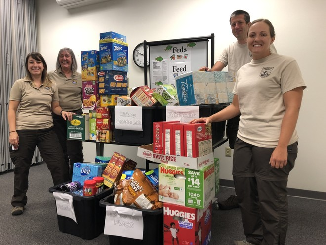 FWS employees show the collected food items