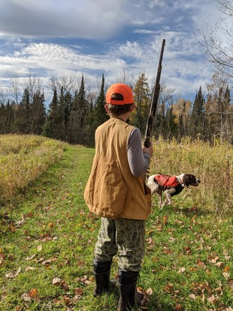youth bird hunter and dog ready for a flush