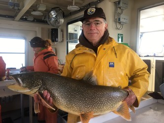 biologist holds large lake trout