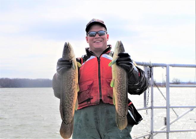 FWS biologist shows bowfin captured during survey