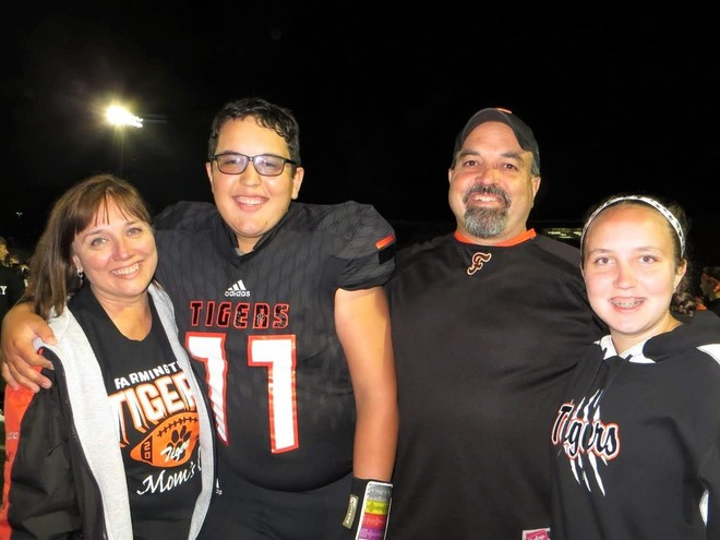 Aaron Woldt and family at a football game