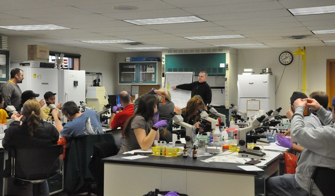 Ken Phillips instructs students at the fish health course