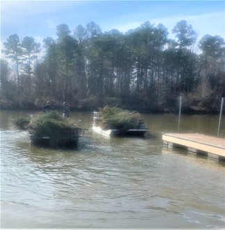 pontoon boats hauling christmas tree habitat structures