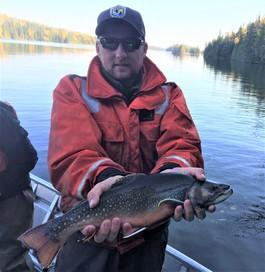 fws staff displays a large brook trout