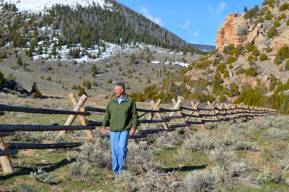 Mark Hogan walks along a fence he helped design and build to protect riparian areas on the Wind River Reservation. Photo: Jennifer Strickland/USFWS