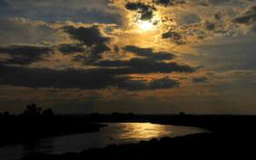 Supermoon and clouds over the Green River Seedskadee National Wildlife Refuge in Wyoming by Tom Koerner/USFWS