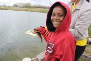 Boy with fish at Lake Mary