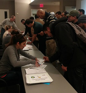 Members of community organizations helped register particpants for the construction safety training event held March 23 at the New York Institute of Technology
