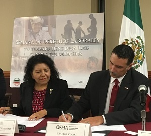 Travis Clark, director of OSHA's Corpus Christi Area Office signs alliance renewals with Consul General of Mexico, Carolina Zaragoza Flores in Laredo,