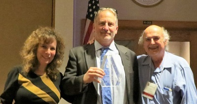 OSHA Deputy Assistant Secretary Jordan Barab (center) receives a Lifetime Achievement Award presented by Marcy Goldstein-Gelb and Peter Dooley of National COSH