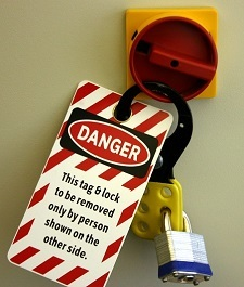 "Lockout/tagout - Photo showing a lock and tag with the words ""This tag & lock to be removed only by person shown on the other side"""