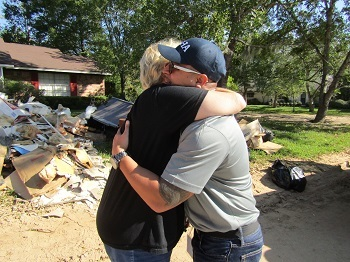 A resident of Friendswood, Texas, hugs OSHA inspector Simon Cabello in gratitude for the help the agency provided her and her husband during the Hurricane Harvey recovery efforts.