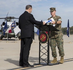 OSHA Regional Administrator Richard Mendelson presents Lt. Colonel Daniel Murphy with a VPP flag and plaque indicating MCAF's status as a Star worksit