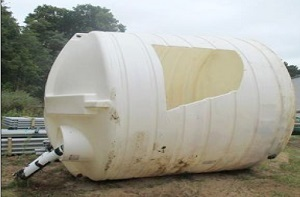 A hole was cut into the side of this whey tank to reach the worker inside.