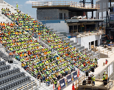 Construction workers stand-down to learn about fall prevention at a May 7 kick-off event held in the new DC United soccer stadium.