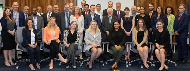 Deputy Assistant Secretary Loren Sweatt, USDOL-OSHA, (seated, center), and members of the OSHA Alliance Program Forum pose for a picture on May 3 in Washington, DC.